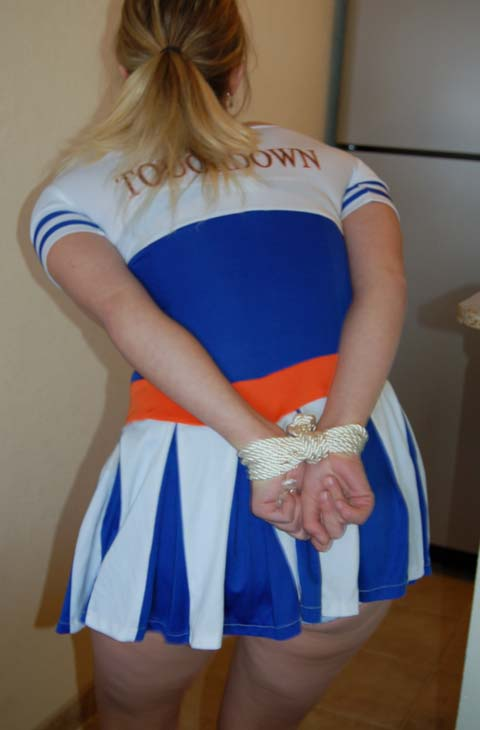 Tied Up Cheerleader Peeing In Her Knickers